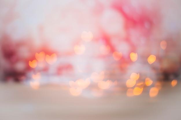 抽象的なbokeh背景の赤みで輝きます 無料写真