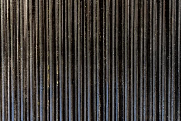 Strisce verticali astratte della parete d'acciaio Foto Gratuite