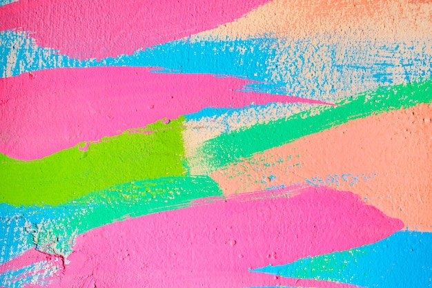 Abstract texture of plaster from wavy lines from a brush of pink, blue, green and beige color. Premium Photo