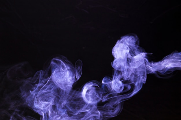 Abstract and texture of purple magic smoke on black background Free Photo