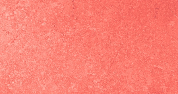 Abstract textured background in living coral color of the year 2019 Premium Photo