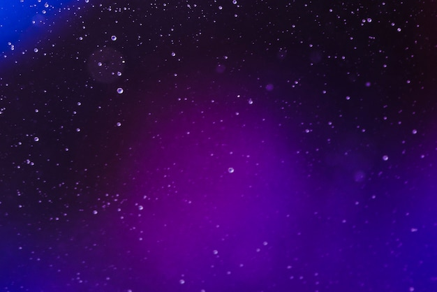 Abstract tiny air bubbles in fluid on blurred gradient background Free Photo