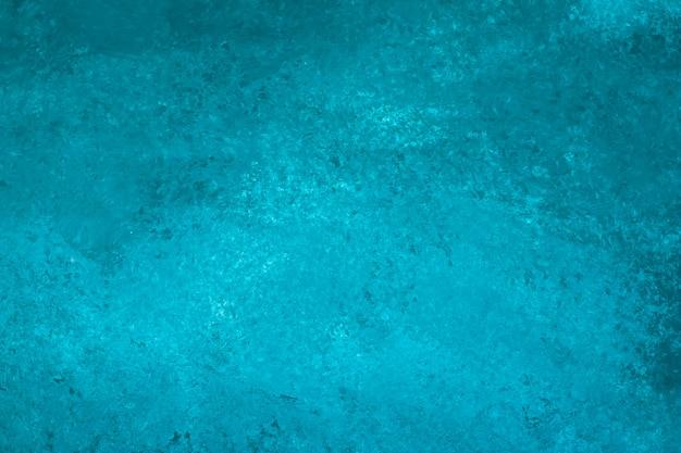 抽象的なターコイズ塗装、キャンバス。暗い水彩画の背景。ステンドアートの壁紙、紙のアクアカラーのテクスチャ。 Premium写真
