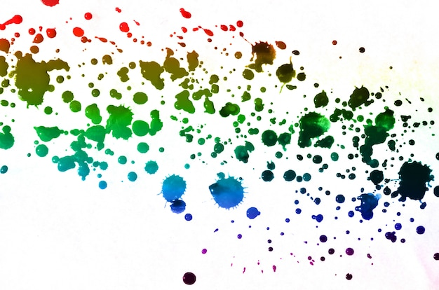 Abstract watercolor paint drops splash of multi-colored ink stains of all colors. Premium Photo