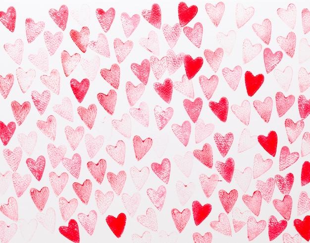 抽象的な水彩画の赤、ピンクのハートの背景。コンセプトの愛、バレンタインの日グリーティングカード。 Premium写真