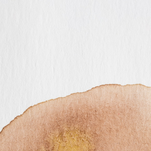 Abstract watercolour background with a brown splatter of aquarelle paint Free Photo