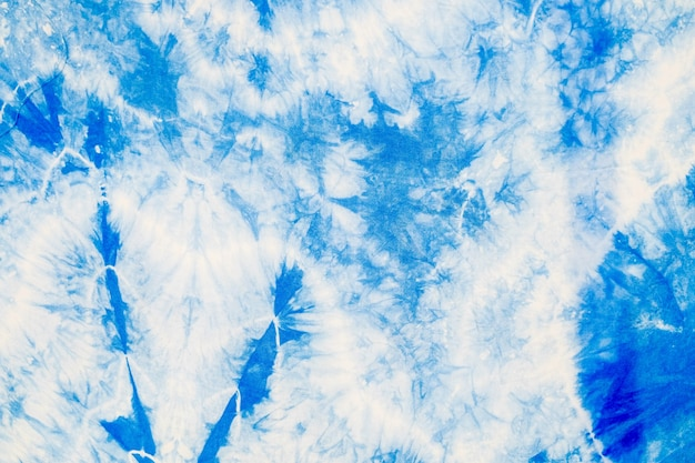 Abstract of the white fabric dyed with indigo blue ink to become batik cloth Premium Photo