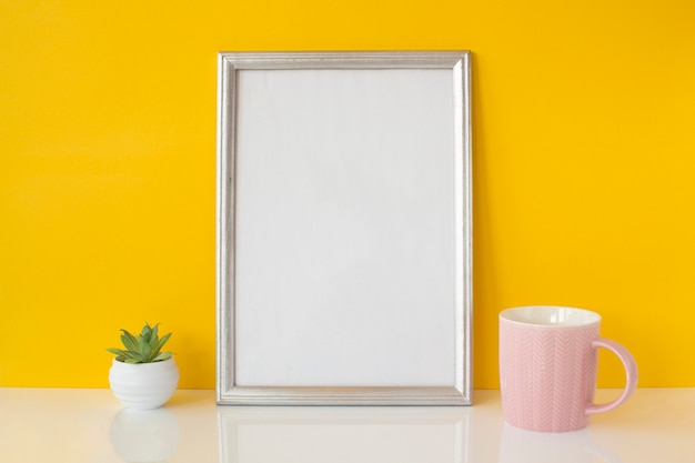 Abstract white frame with ceramic cup Free Photo