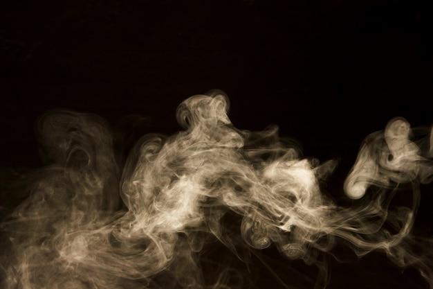 Abstract white smoke on black background Free Photo