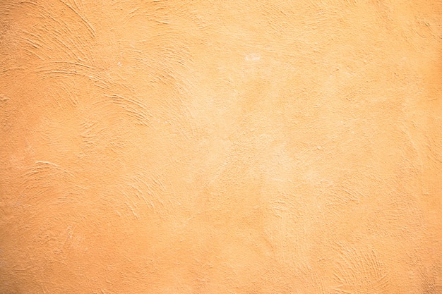 Abstract yellow cement wall texture background Premium Photo