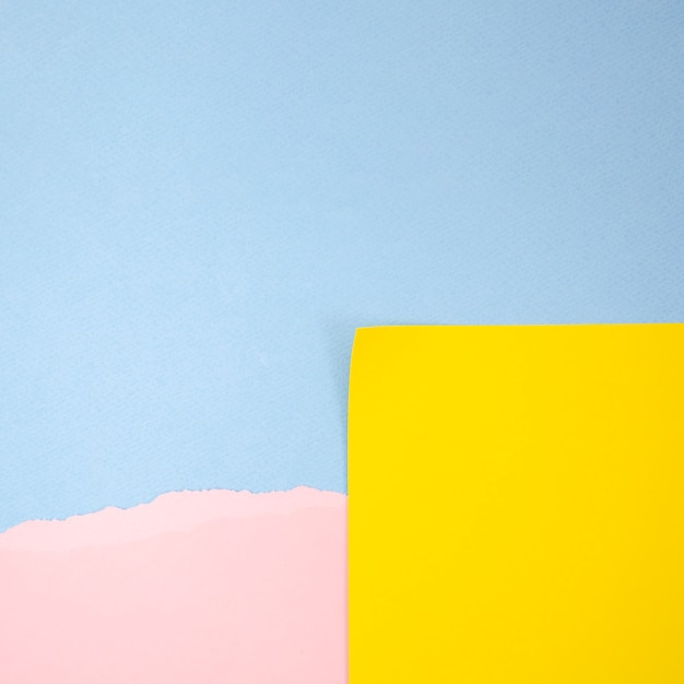 Abstract yellow and pink post-it with blue copy space background Free Photo