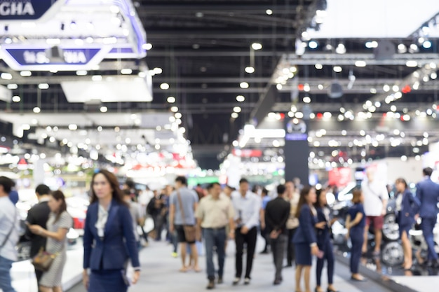 Abtract blur people in exhibition hall motor show event background Premium Photo
