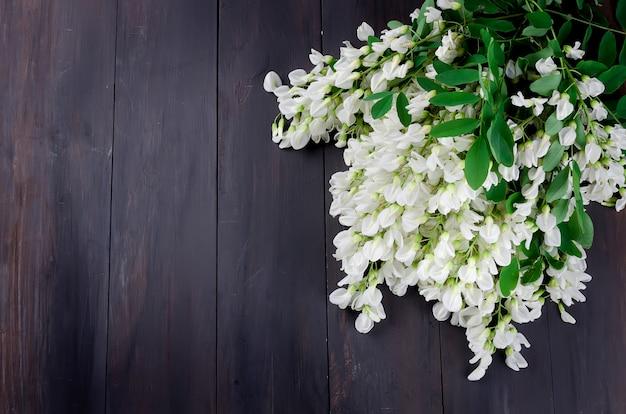 Acacia flowers on a dark wooden background Premium Photo