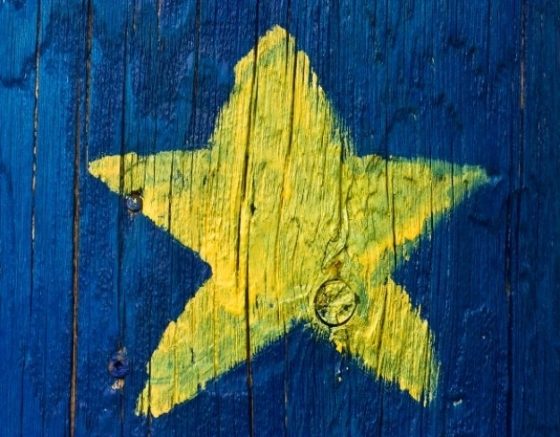 Acadian star painted on wood Free Photo