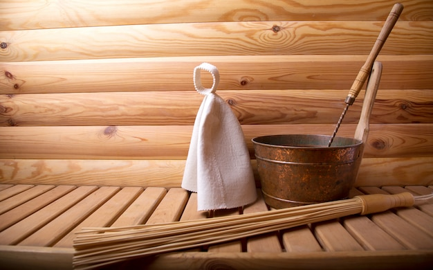 Accessories for  bath and sauna on a wooden sauna. Premium Photo