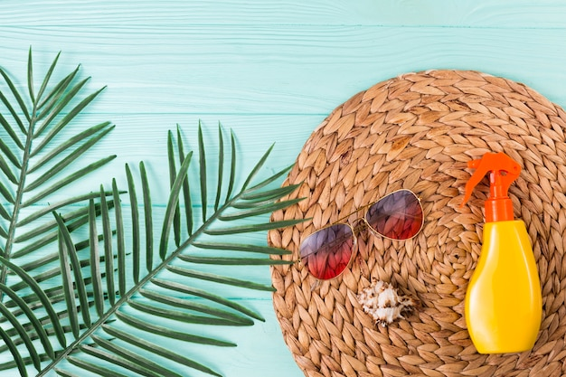 Accessories for beach leisure and palm leaves Free Photo