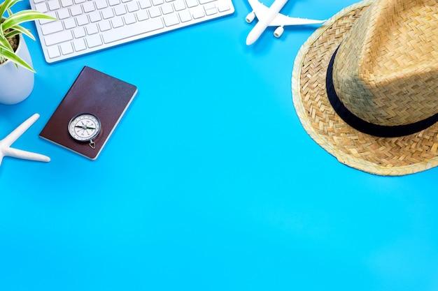 Accessories of traveler on blue table Premium Photo
