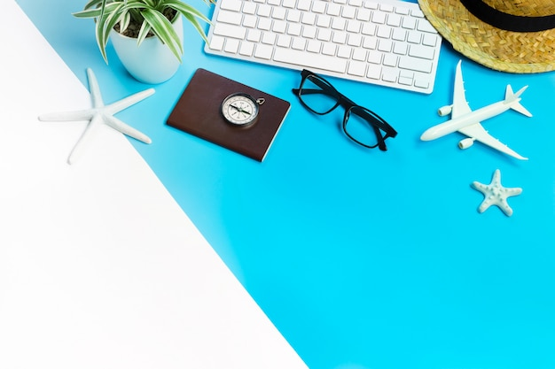 Accessories of traveler on blue and white table Premium Photo