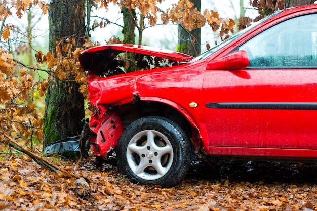 Accident, car crashed into tree Premium Photo