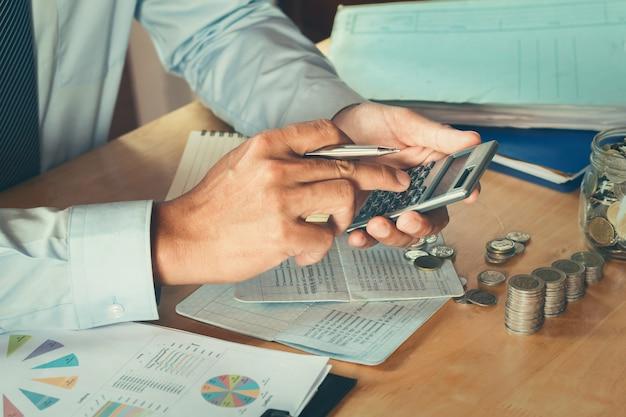accountant using calculator calculate budget for saving concept