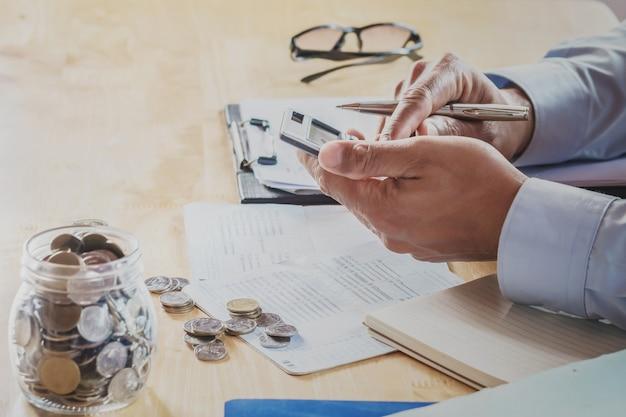accountant using calculator calculate budget for saving photo