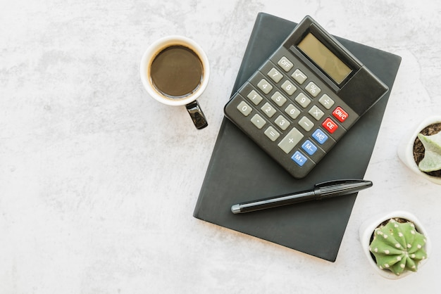 Accountant workplace with coffee Free Photo