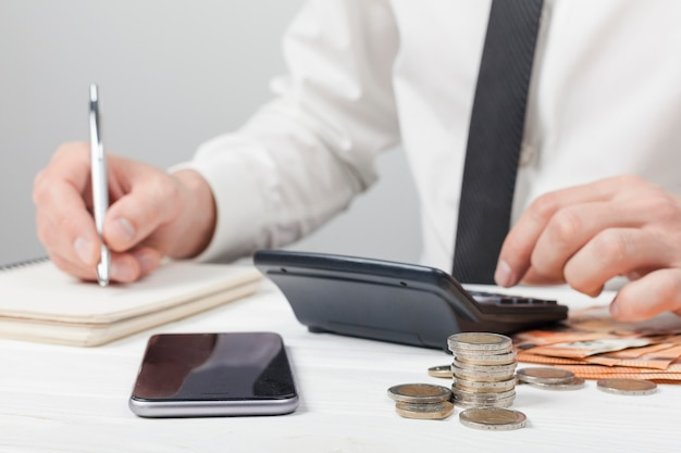 Accountant writing on a notebook Premium Photo
