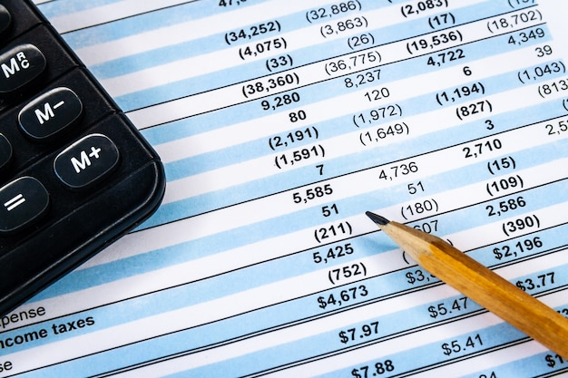 Accounting business. calculator with accounting report and financial statement Premium Photo