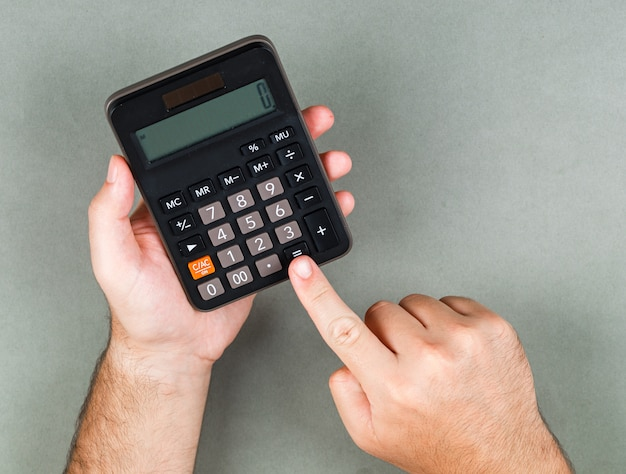 Accounting and calculation concept on gray surface top view. someone calculating something. horizontal image Free Photo