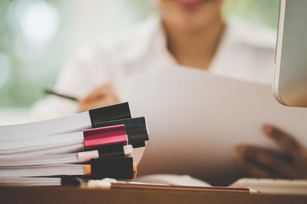 Accounting planning budget report file concept : business woman offices check working for arranging Premium Photo