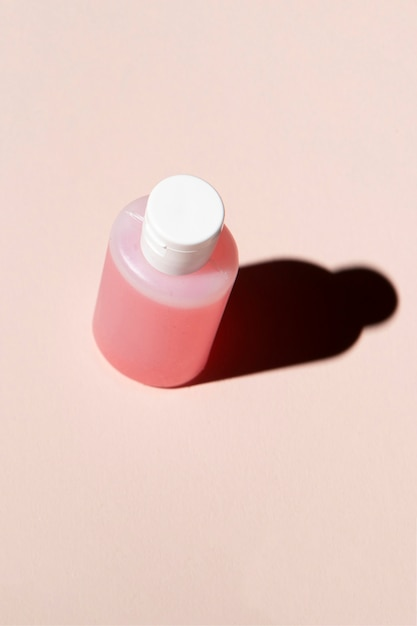 Acetone bottle on plain background Free Photo