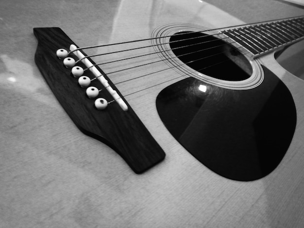 Acoustic guitar foreground Free Photo