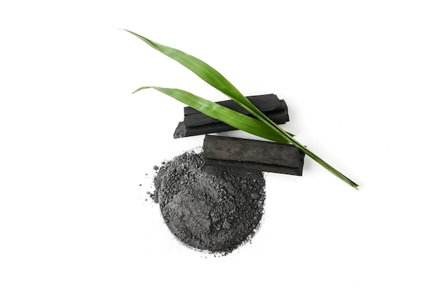 Activated charcoal powder on white background Premium Photo