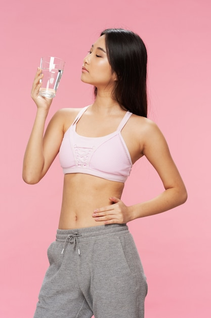 Active asian woman with a glass of water Premium Photo