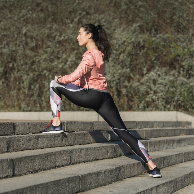 Active female stretching outdoor Free Photo
