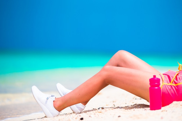 Active fit young woman in her sportswear during beach vacation Premium Photo