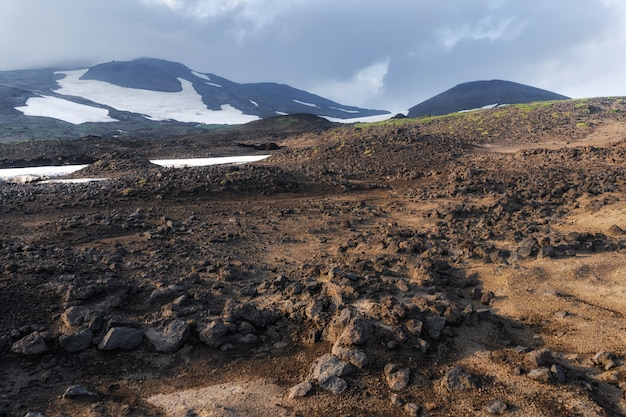 The active lava flow from a new crater on the slopes of volcanoes tolbachik - kamchatka, russia Premium Photo