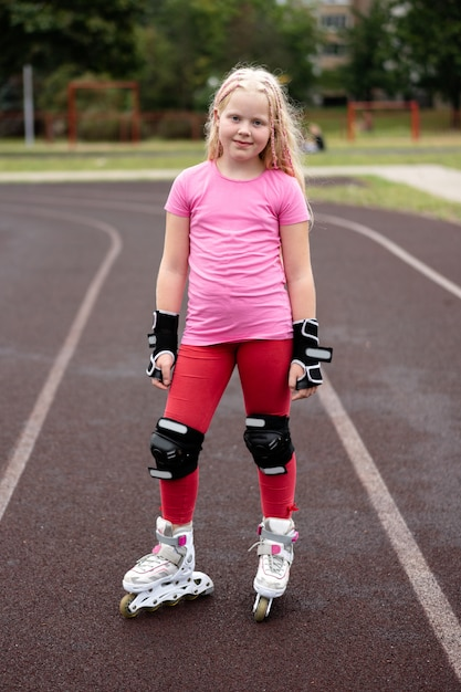 Active lifestyle in a modern city - stylish girl roller-blading in a stadium Premium Photo