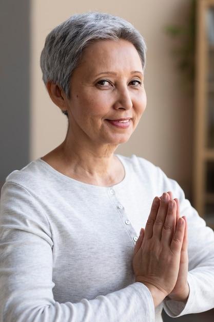 Active senior woman training at home Free Photo