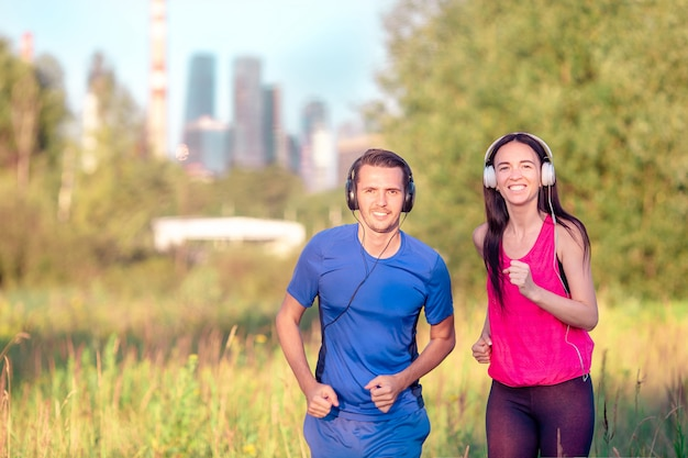 Active sportive couple running in park. health and fitness. Premium Photo