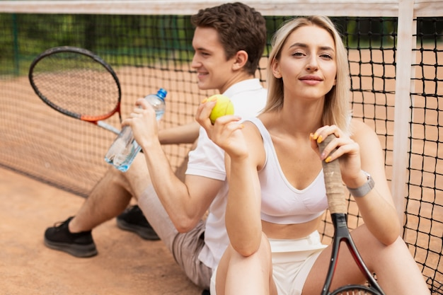 Active tennis couple taking a break Free Photo