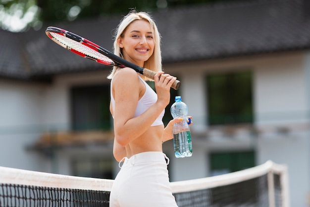 Active young girl holding water bottle Free Photo
