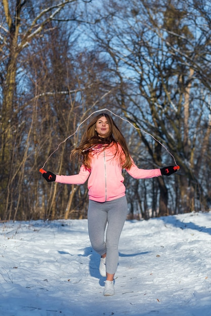 Active young woman performs an exercise with a skipping rope Premium Photo