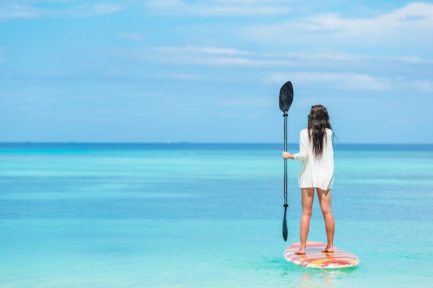 Active young woman on stand up paddle board Premium Photo