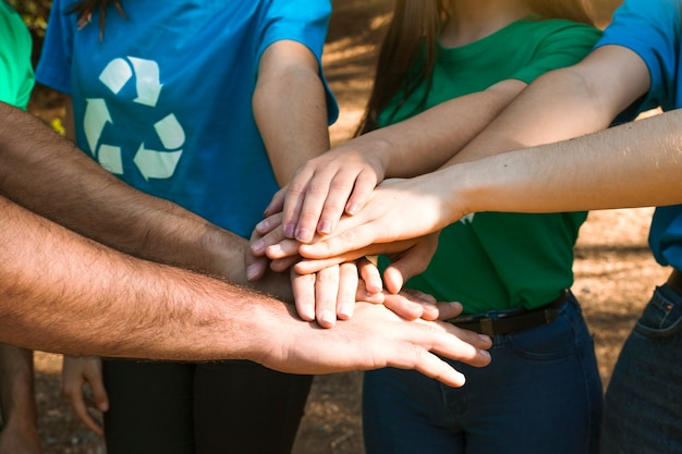 Activists hands together on team building Free Photo