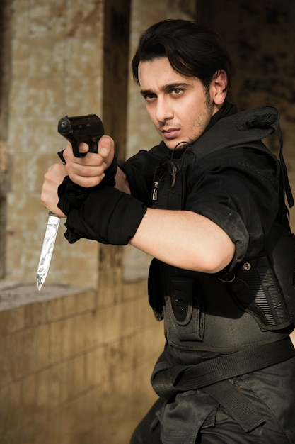 An actor performing police scene with a weapon Free Photo