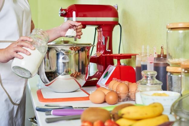 Adding some flour Free Photo