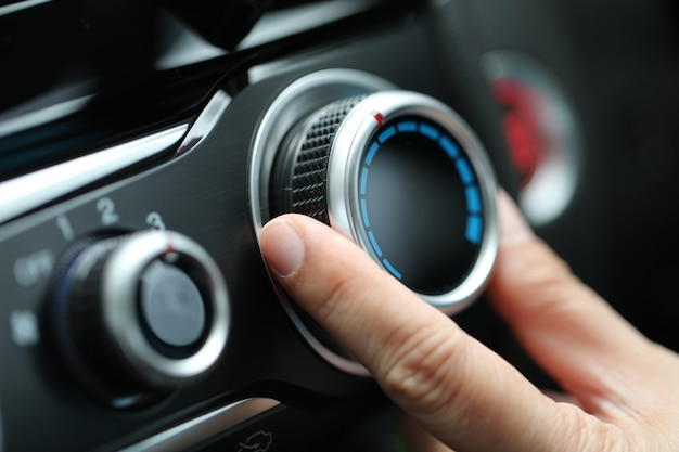 Adjust air conditioner on dashboard in the car. Premium Photo