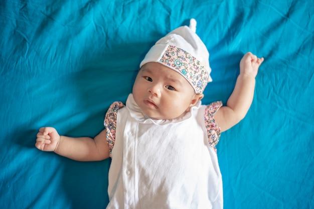 Adorable baby newborn  girl  in  bedroom Premium Photo
