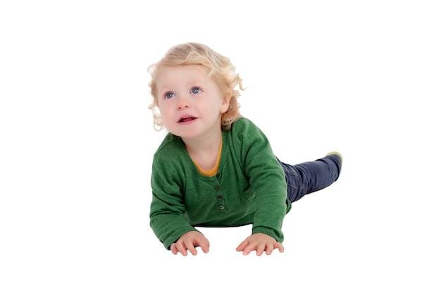 Adorable blond baby lying on the floor Premium Photo